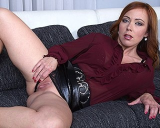Horny mom masturbating on her couch