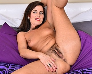 Hairy mom playing with her furry pussy