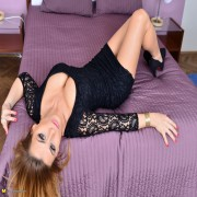 Hot steamy mom playing with herself on bed